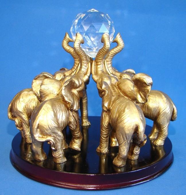 Six elephants holding crystal ball - Feng shui elephant placement ...
