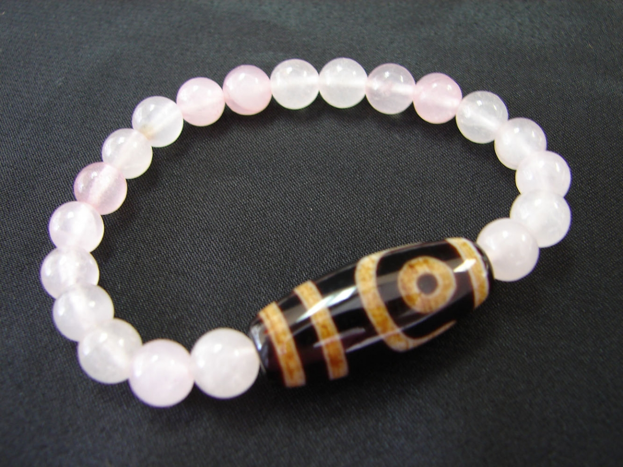 2 eye dzi with quartz bead bracelet