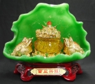 Two Golden Money Frogs on Green Lotus
